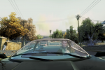 Niko drives a black car through a residential area.