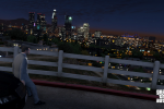 Michael gazes out at the city lights
