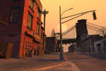 An empty street glows orange at sunset (or sunrise!)