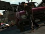 Niko uses a car as cover