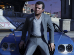 Michael sits on a car
