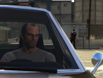 Trevor waits outside the prison