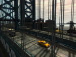 A few vehicles drive across a large bridge.