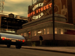 Niko drives past the 69th street diner as a man walks out.