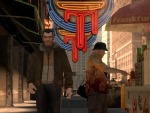 Niko walks past a man ordering food from a hot dog vendor.