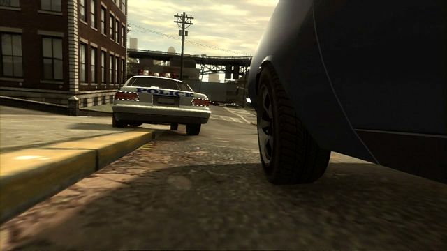 Niko tails a police car over a curb.