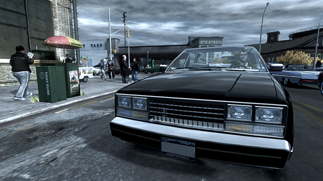 Niko drives a black vehicle while the sky above is dark and grey.