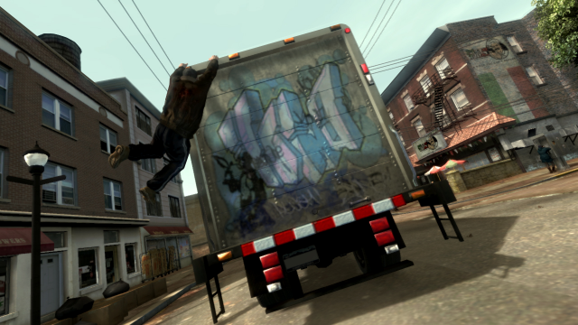 Niko hangs onto a truck