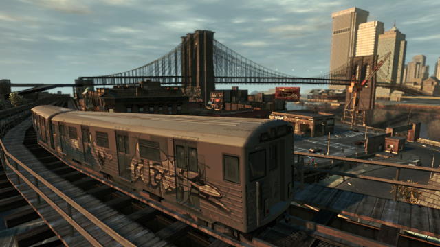 A train heads around the tracks towards the big city.