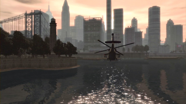 A helicopter flies towards the city