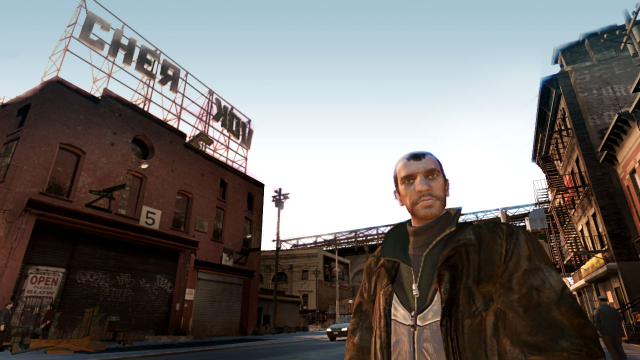 Niko stands in front of a humorous 'Cherkov' building.