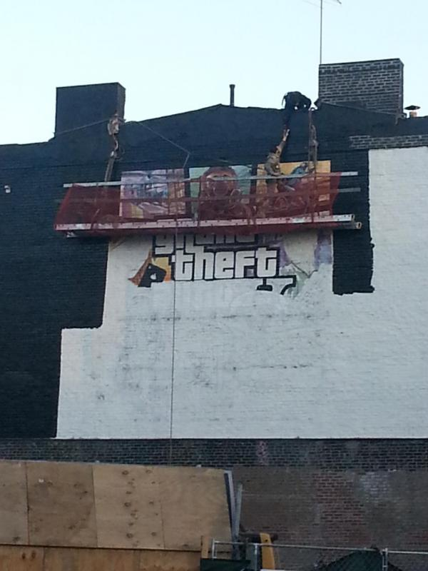 GTA V Cover Art Ad in NYC Being Painted