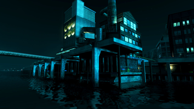 A beautifully lit building on the water at night.