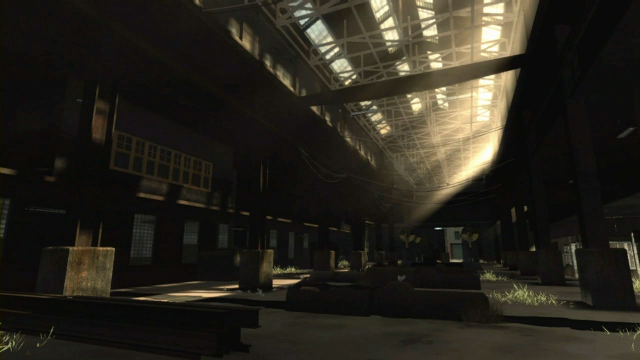 The sunlight brightens a dark warehouse.